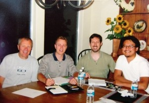 Call-Em-All's founders shake hands at the kitchen table.  History is made.